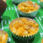 A football field of tinfoil cups of baked mac and cheese