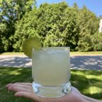 A rocks glass with Paloma and a lime wedge.