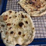 freshly cooked naan resting on a cooling rack