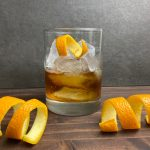An Oaxaca old fashioned in a rocks glass, garnished with an orange twist