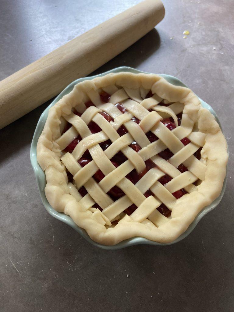 Freshly laced lattice crust over honey bourbon cherry filling