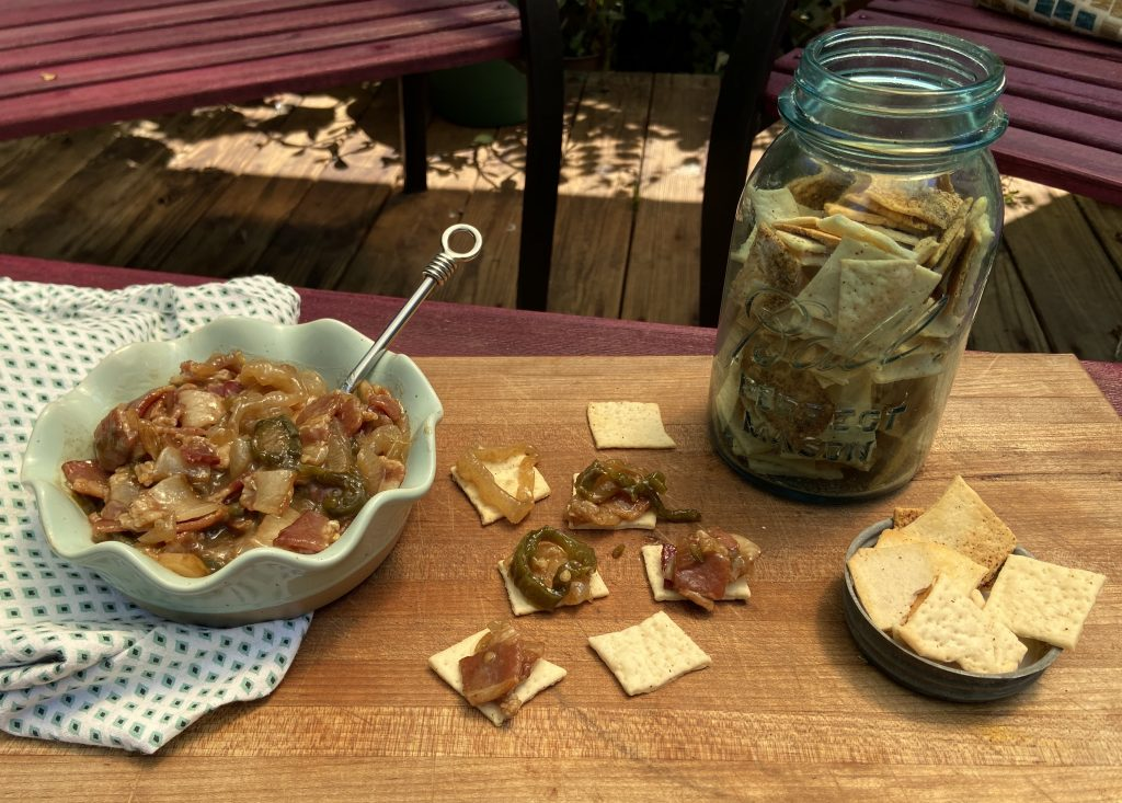 A jam made of jalapeno's, bacon pieces, and onions used to top homemade crackers