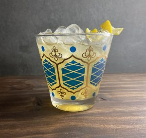 Ice cold bourbon and apricot brandy splashed with lemon on the rocks, a Baltimore Blast!