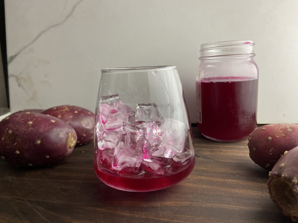 Homemade prickly pear syrup on the rocks for margaritas